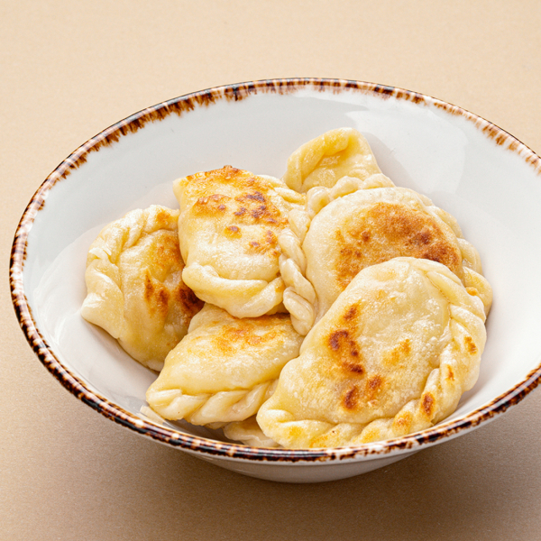 Вареники по-украински с картофелем и шкварками